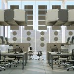 Pannelli fonoassorbenti in due colorazioni in sospensione in ufficio open space